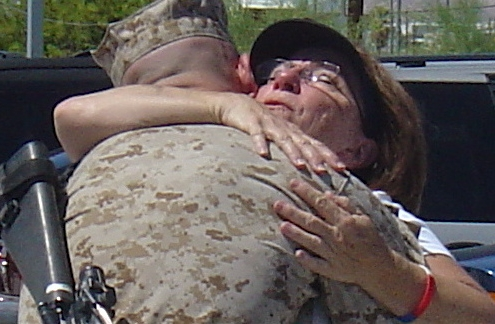 Mother hugs her Marine son