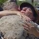 Mother hugs her Marine son